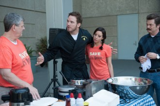 """PARKS AND RECREATION -- """"Save JJ's"""" Episode 707 -- Pictured: (l-r) Brent Briscoe as JJ, Chris Pratt as Andy Dwyer, Aubrey Plaza as April Ludgate, Nick Offerman as Ron Swanson -- (Photo by: Colleen Hayes/NBC)"""