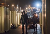 "Arrow -- ""Canaries"" -- Image AR313B_0033b -- Pictured (L-R): Stephen Amell as Oliver Queen / The Arrow and Colton Haynes as Roy Harper / Arsenal -- Photo: Diyah Pera/The CW -- © 2015 The CW Network, LLC. All Rights Reserved."