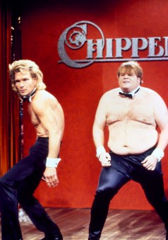 "SNL 40TH ANNIVERSARY SPECIAL -- Season 17, Episode 4 -- Pictured: (l-r) Patrick Swayze as Adrian, Chris Farley as Barney during ""Chippendales Audition"" skit on October 27, 1990 -- (Photo by: Al Levine/NBC)"