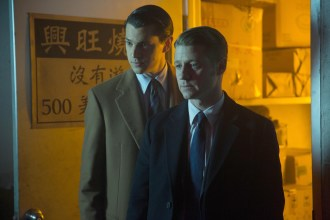 """GOTHAM: Gordon (Ben McKenzie, R) and Dent (guest star Nicholas D'Agosto, L) investigate a lead in the """"Everyone Has A Cobblepot"""" episode of GOTHAM airing Monday, March 2 (8:00-9:00 PM ET/PT) on FOX. ©2015 Fox Broadcasting Co. Cr: Jessica Miglio/FOX"""