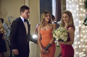 "Arrow -- ""Suicidal Tendencies"" -- Image AR317A_0313b -- Pictured (L-R): Stephen Amell as Oliver Queen, Katie Cassidy as Laurel Lance, and Emily Bett Rickards as Felicity Smoak -- Photo: Katie Yu/The CW -- © 2015 The CW Network, LLC. All Rights Reserved."