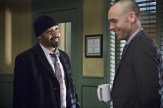 """The Flash -- """"Who is Harrison Wells?"""" -- Image FLA119B_0342b -- Pictured (L-R): Jesse L. Martin as Detective Joe West and Paul Blackthorne as Quentin Lance -- Photo: Katie Yu /The CW -- �© 2015 The CW Network, LLC. All rights reserved."""