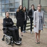 """The Flash -- """"All Star Team Up"""" -- Image FLA118A_0034b -- Pictured (L-R): Tom Cavanagh as Harrison Wells, Danielle Panabaker as Caitlin Snow, Carlos Valdes as Cisco Ramon, Grant Gustin as Barry Allen, and Emily Bett Rickards as Felicity Smoak -- Photo: Cate Cameron/The CW -- �© 2015 The CW Network, LLC. All rights reserved."""