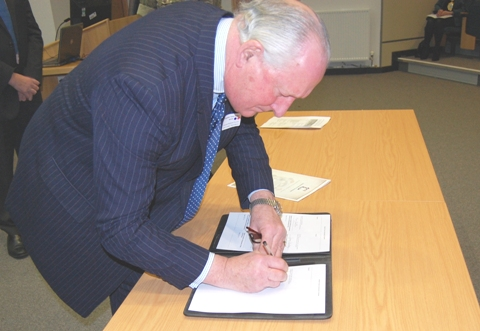 Brigadier Tony Dalby-Welsh signing the declaration