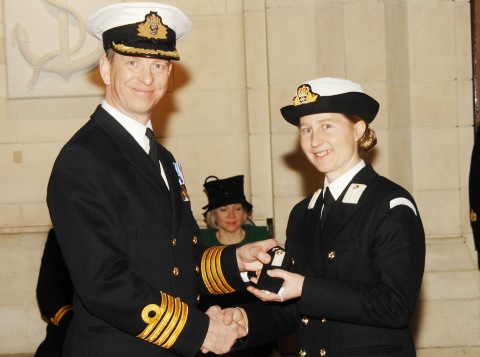 Mid Claire Rossiter receives her Midshipman 'rank slides' from the COCaptain Jerry Kyd of Britannia Royal Naval College