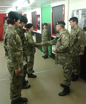Captain Betty presenting Heartstart certificates to Cadets Thomas Williams (shaking Captain Betty's hand), Paul Brammel and Elliot Morran (from right to left)