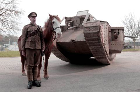 Trooper Kieran Sherring with 'warhorse' Adam and an original First World War tank. Picture courtesy of the Tank Museum.