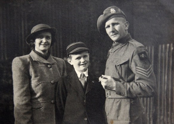 Albert with his wife Olive and son Brian, on his return home late in 1946.