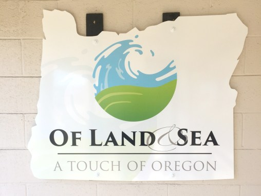 Of Land & Sea – Sign