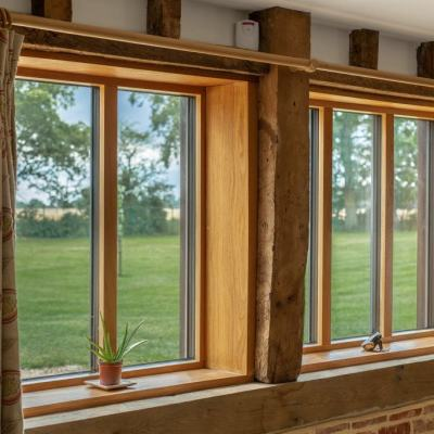 Achieve the perfect balance of style and function with natural oak composite windows