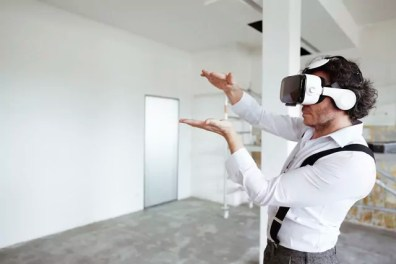 Architect using Virtual Reality Glasses at construction site