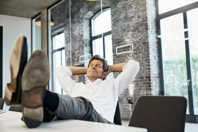 Mature businessman relaxing in conference room of modern office