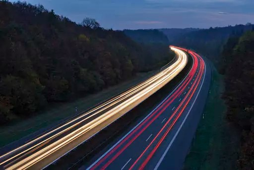 Germany, Bavaria, Traffic light trails on motorway at twilight