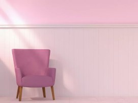 Armchair standing in front of wooden wall cladding, 3D Rendering