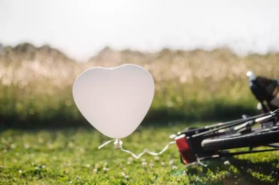 Bicycle and white balloon