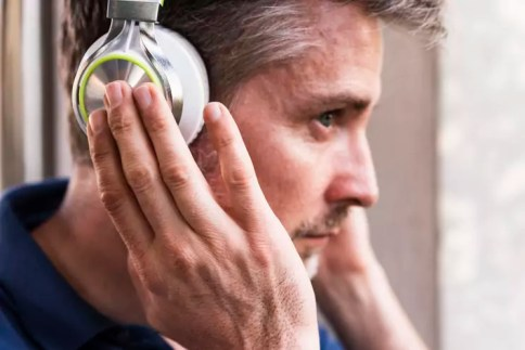 Man listening music with headphones, close-up