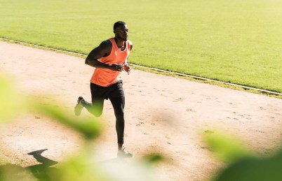 Young athlete on sports field training running