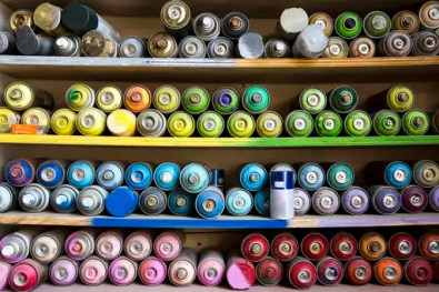 Close-up of spray paints arranged on shelves