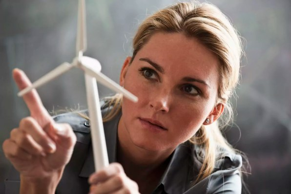 Woman with model wind turbine
