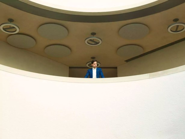 Young man on balcony at Blavatnik School of Government in England