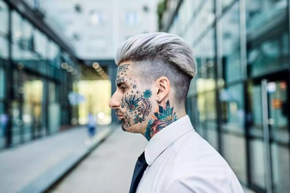 Young businessman with tattooed face, portrait
