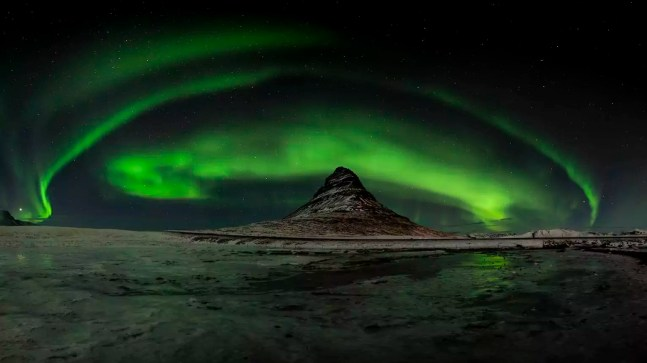Iceland, Northen lights at Kirkjufell mountain