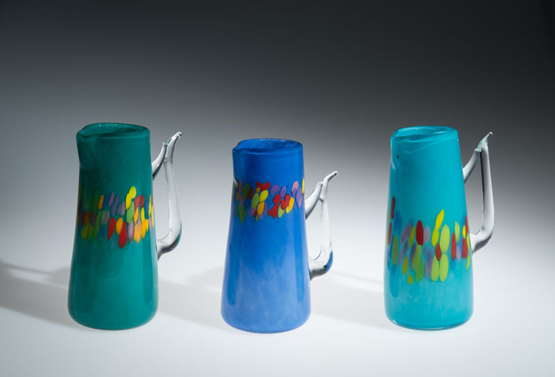 "David Buck ""Turquoise, Dutch Blue and Sea Blue Pitchers"" (shown L-R) blown glass"