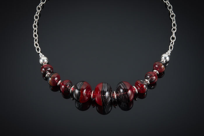 """Becky Congdon """"Fragile Heart Necklace"""" 21.5"""" handmade flameworked glass hollow beads w/ sterling silver beads and chain $300.SOLD (photo by Ann Cady)"""