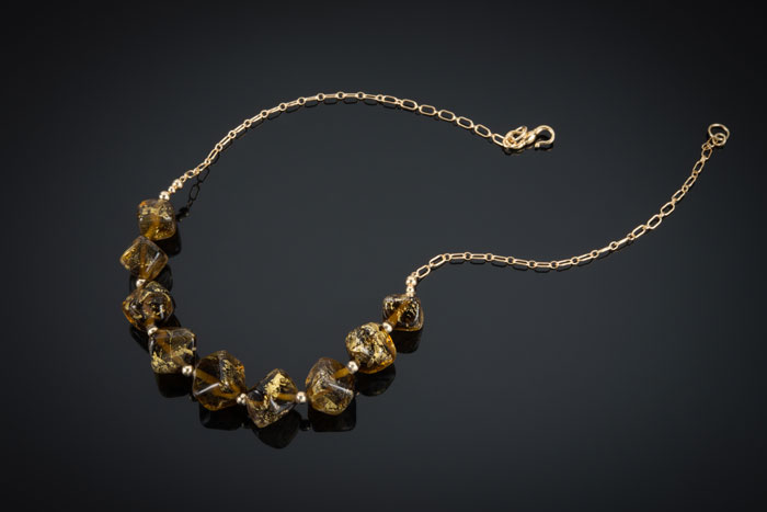"""Becky Congdon """"Maple Gold Nuggets Necklace"""" 20"""" handmade flameworked glassand gold leaf beads with gold filled beads and chain (photo by Ann Cady) $300. SOLD"""