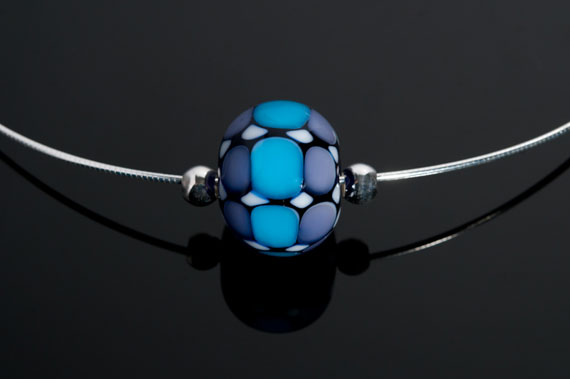 """Becky Congdon """"Mathematical Order Omega"""" handmade flameworked glass bead with sterling silver findings/chain 18"""" $95. Inquire on availability(photo by Ann Cady)"""