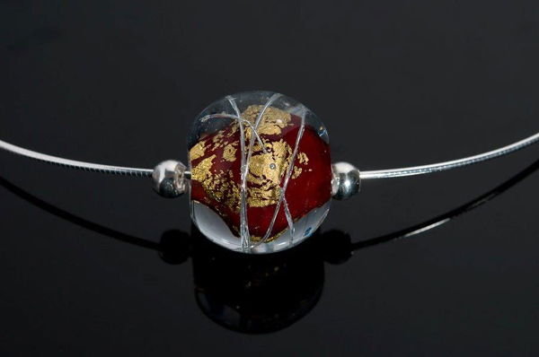 """Becky Congdon """"Red Cosmos Omega"""" handmade flameworked glass bead with gold leaf and sterling silver findings/chain 18"""" $95. Inquire on availability (photo by Ann Cady)"""