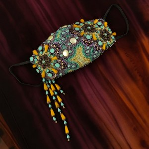 """San Fortune """"Happiness Can Make It Through"""" View B face mask made of fabric, 3 filigree metal flowers, coin freshwater pearls, glass drops, glass discs, glass triangle beads, glass dome beads and various other glass beads $435. SOLD"""