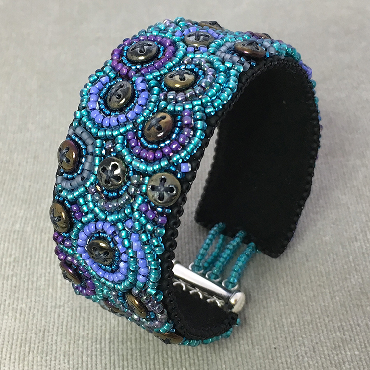 "San Fortune ""Purple and Teal Cuff"" bead embroidery w/ sterling clasp 1"" wide $163. SOLD"