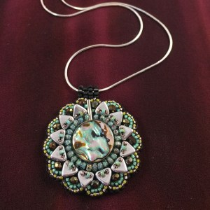 """San Fortune """"Abalone Pendant"""" 18"""" sterling silver chain with abalone shell, Miyuki glass seed beads, 6mm triangle beads, Swarovski crystals $80."""