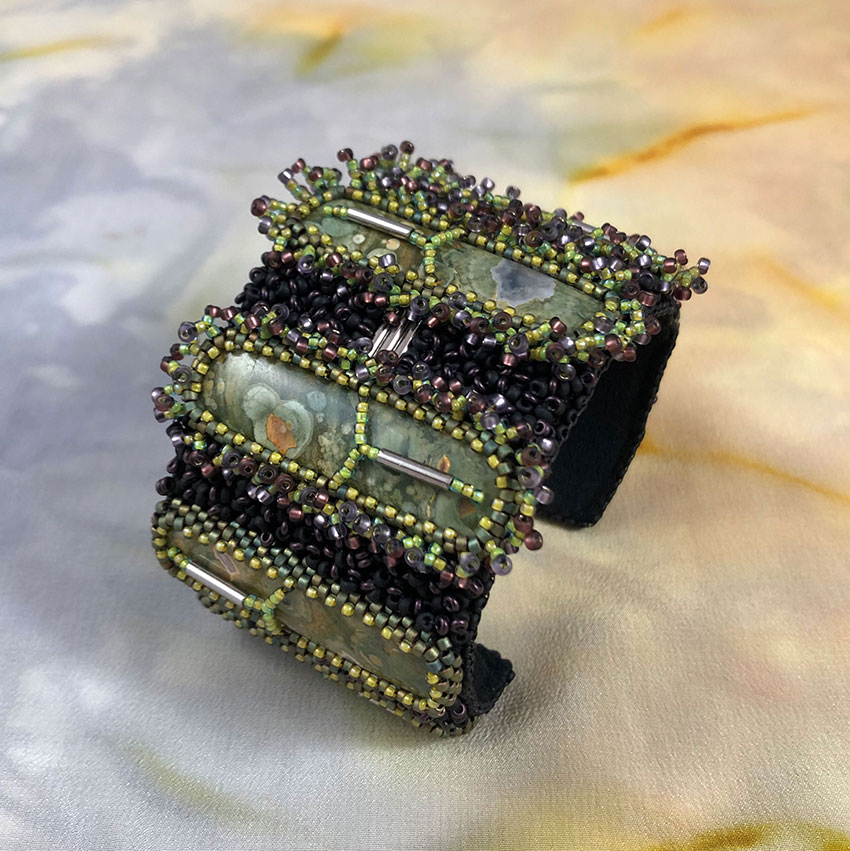 "San Fortune ""Green Rhyolite Cuff - 7 stones"" with glass seed/bugle beads $279."
