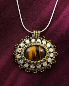 """San Fortune """"Tiger Eye Pendant with Yellow"""" (View A) Tiger Eye, yellow crystal cup chain, glass seed bead bezel, various glass seed beads, 18"""" sterling silver snake chain $85."""