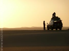 Preparing the camp at sunset