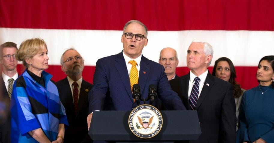Washington State Gov. Jay Inslee addresses the media during a visit by Vice President Mike Pence to discuss concerns over the coronavirus, COVID-19, on March 5, 2020, at Camp Murray, adjacent to Joint Base Lewis-McChord, Washington.