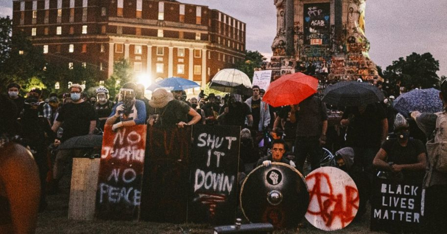 Protesters make a wall with homemade shields and umbrellas on June 23, 2020, in Richmond, Virginia.