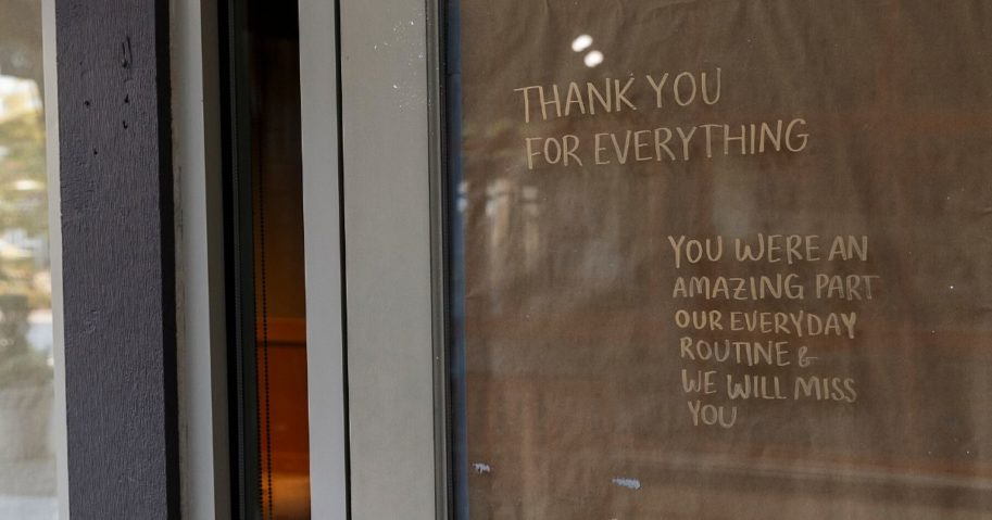 """A note reading """"Thank You For Everything"""" is displayed on the door of a permanently closed Starbucks Coffee shop in Dundarave Village Mews on May 15, 2020, in West Vancouver, British Columbia, Canada."""