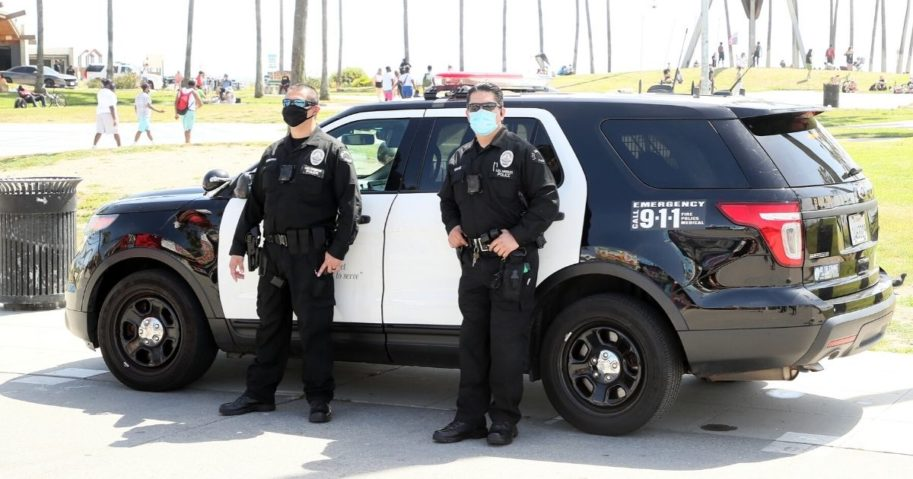 Los Angeles Police Department officers wearing protective face masks are seen on May 16, 2020 in Venice, California.