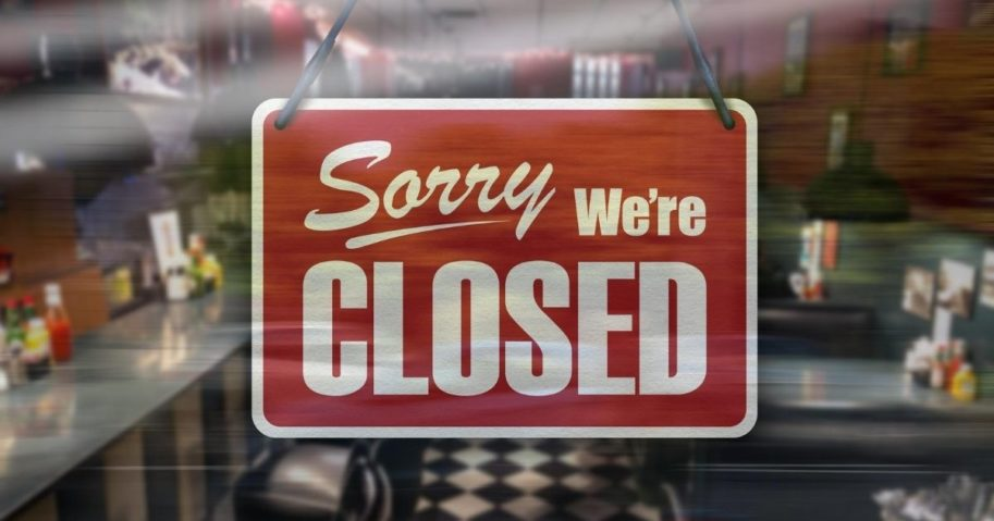 """A stock image of a sign on a restaurant window reading """"Sorry, we're closed"""" is pictured above."""