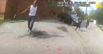 Deon Kay is seen with a handgun before he was shot by Washington, D.C., police officers.