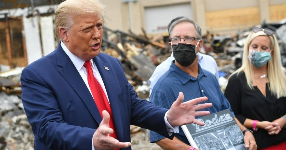 President Donald Trump speaks to the media amid the rubble in Kenosha, Wisconsin, on Sept. 1, 2020.