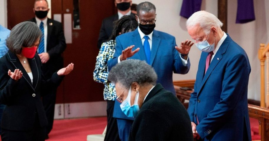 Former Vice President Joe Biden prays as he meets with clergy members and community activists during a visit to Bethel AME Church in Wilmington, Delaware, on June 1, 2020.