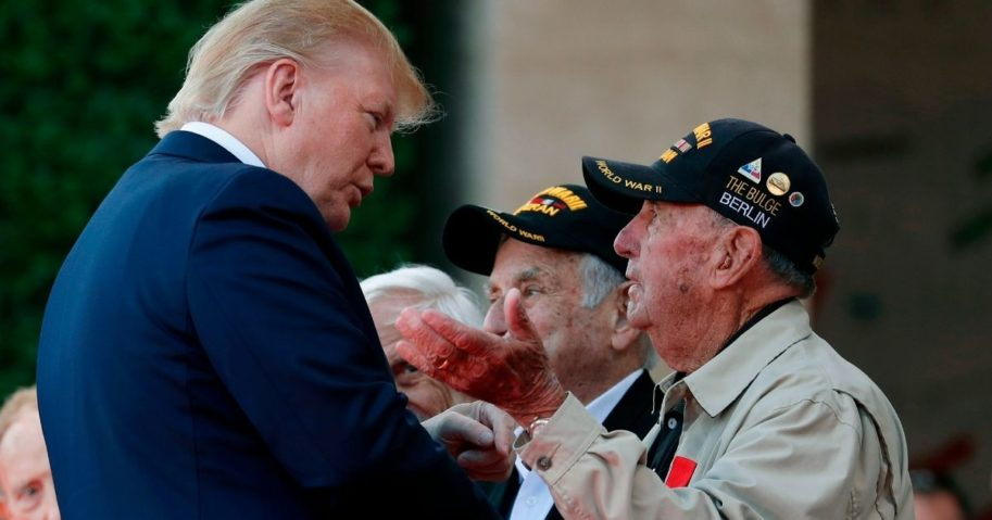 President Donald Trump greets a veteran during a French-U.S. ceremony at the Normandy American Cemetery and Memorial in Colleville-sur-Mer, France, on June 6, 2019, as part of D-Day commemorations marking the 75th anniversary of the World War II Allied landings in Normandy.