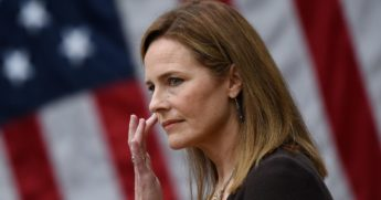 Federal Judge Amy Coney Barrett listens as she is nominated to the Supreme Court on Saturday by President Donald Trump in the Rose Garden of the White House.