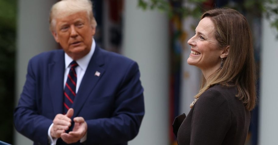 President Donald Trump applauds Saturday after introducing federalJudge Amy Coney Barrett as his nominee for the Supreme Court.