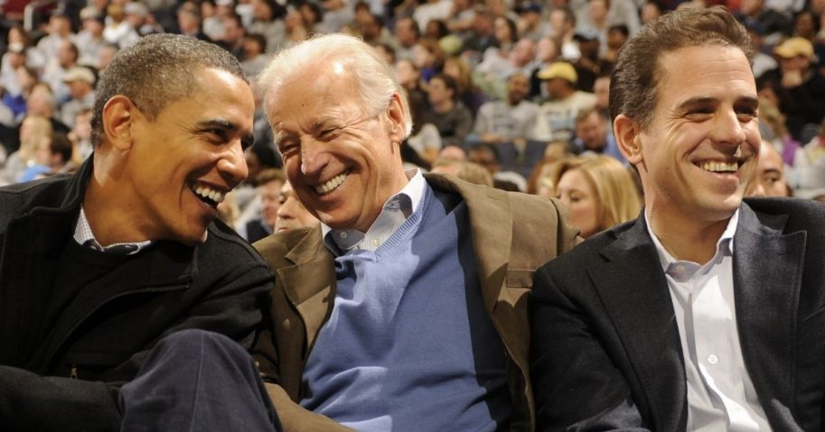 President Barack Obama, Vice President Joe Biden and Hunter Biden have a laugh during a college basketball game between the Georgetown Hoyas and Duke Blue Devils the Verizon Center in Washington on on Jan. 30, 2010.