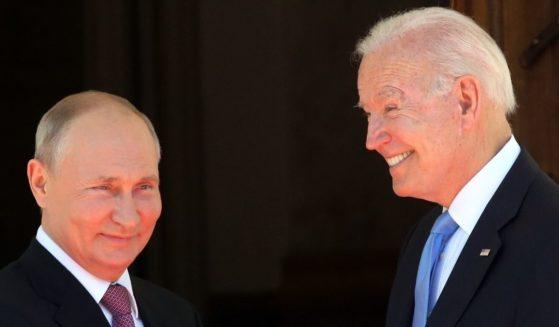 Russian President Vladimir Putin, left, greets a smiling President Joe Biden at the La Grange Villa in Geneva on Wednesday.